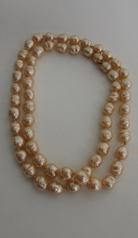 "Chanel from  1981...Single strand of large champagne  baroque pearls...18"" long, 36"" end to end...there is no clasp on this necklace it just slips over your head"