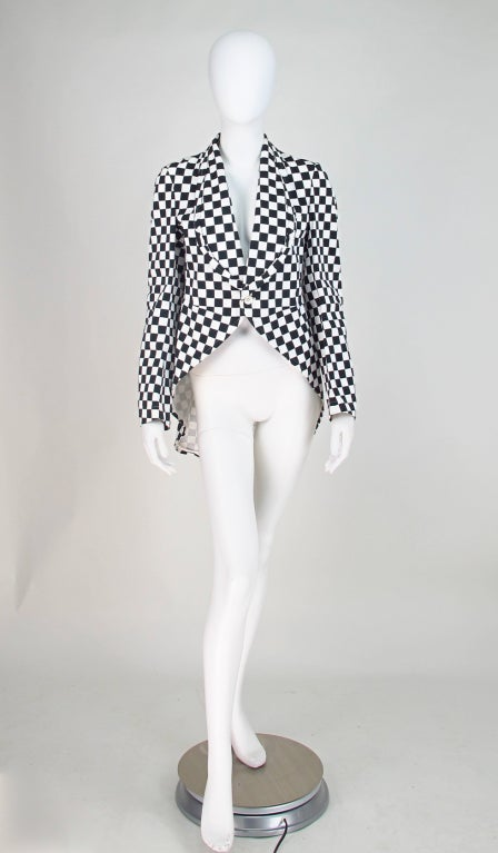 Black & white cotton cutaway coat from the 2000s Comme des Garcons...This is actually a mans jacket, but it is small and fits a woman nicely, with all the black and white this season here is a jacket for the fashion avant garde...All our clothing is