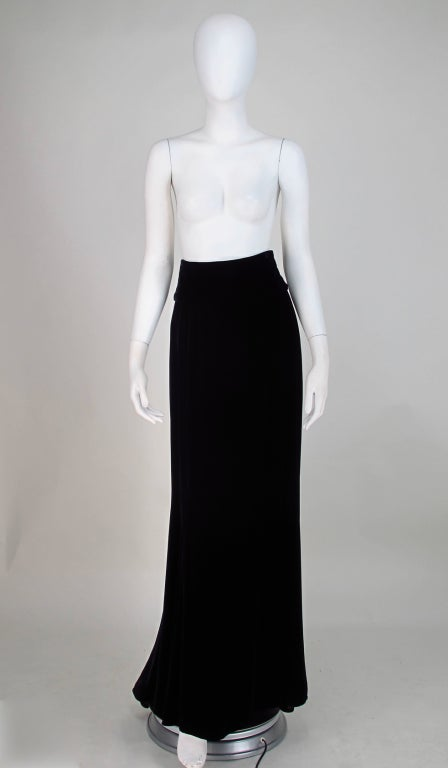 Black velvet maxi skirt with a fish tail train, Ungaro from the 1990s...High wide band waist sits at natural waist...Skirt closes at back with 3 buttons at the waist and a zipper...Marked size 12...  All our clothing is dry cleaned and inspected