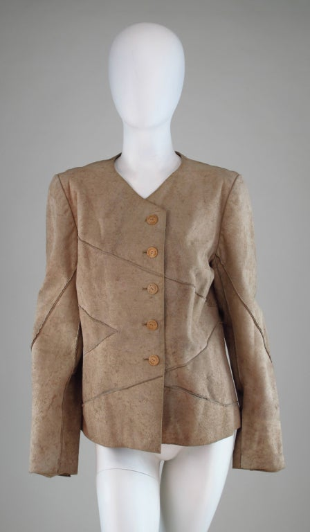 Distressed, pieced buckskin jacket, with wooden logo buttons,on seam (horizontal) front pockets...Chanel, Identification line...Looks barely worn, there is a tiny smudge of pink on the upper shoulder front, that is difficult to see unless seen in