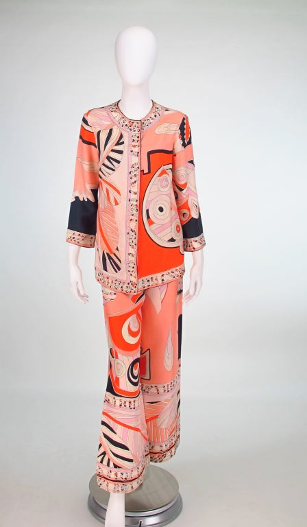 Emilio Pucci silk twill evening pajama in brilliant orange, coral and pale pink with punches of black & white, from the 1960s...Blouse top closes with pearl buttons and a covered placket, round banded neckline and 3/4 length sleeves...The pant has