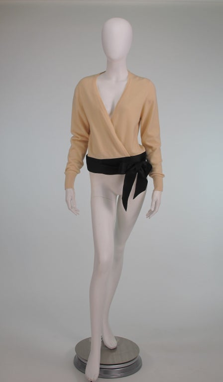 Chanel cream cashmere sweater with wide black silk ribbon wrap...Deep V front when wrapped...Marked size Medium...In excellent wearable condition...