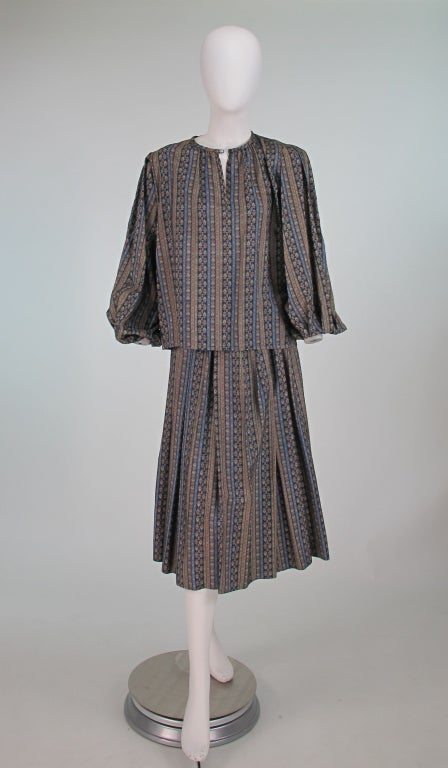Yves St Laurent Rive Gauche silk peasant blouse & matching skirt...Provencal style print in blues, tans, cream and grays...Blouse is pull on style with round neckline closing with a single button and loop, long full sleeves with gathered elastic