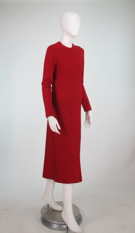 Halston, from the 1970s...one of his specialties was the spiral seam...here a red knit day dress, long sleeve, dress closes at left shoulder with hook and eyes, fabric feels like a soft wool jersey, unlined, diagonal seam at dress back from under