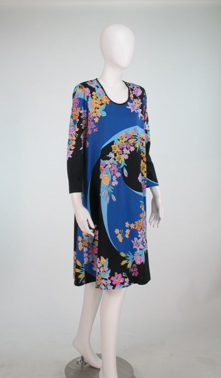 Fine cotton knit tent dress by Averardo Bessi in a floral swirl design...Dress is unlined, closes at the back with a zipper and hook/eye...Looks unworn...Marked size 14...  Measurements are:  Bust 44