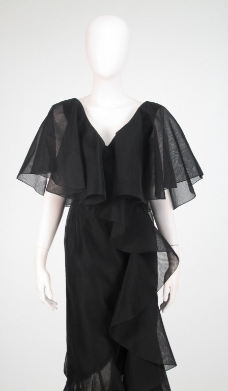 Gorgeous Alfred Bosand black organza cape shoulder gown...Dramatic plunge bodice front and back...deep cape shoulder...gown is fitted through the waist with princess seamed bust, seamed waist with self band, deep flared illusion hem...Body of dress