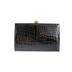 Black crocodile clutch handbag