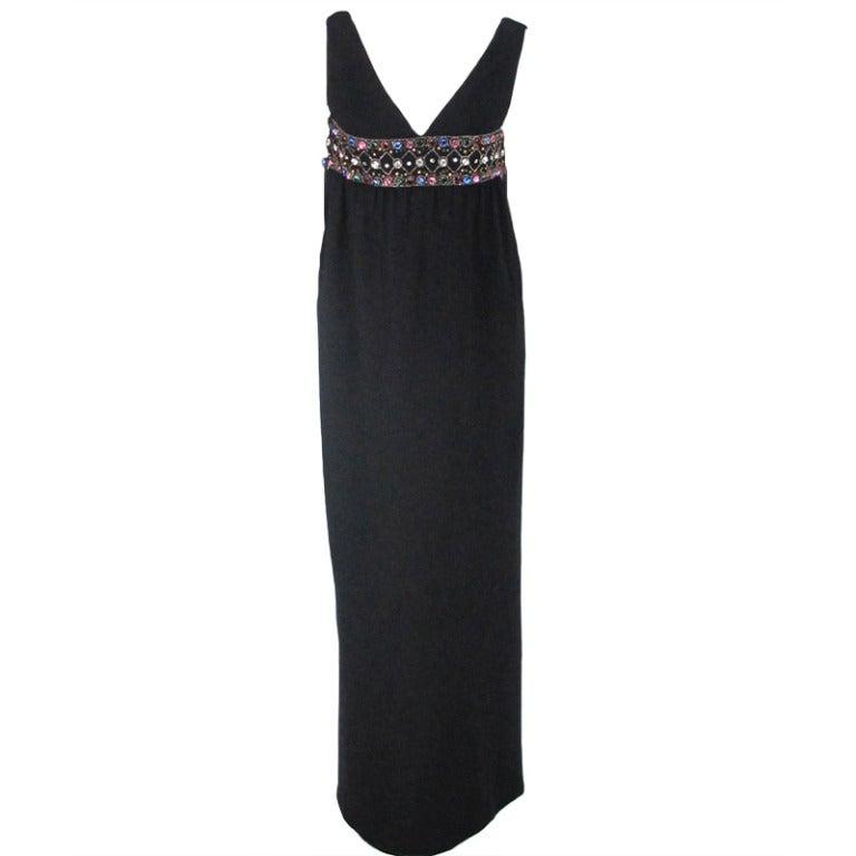 Elizabeth Arden black plunge neck column gown with jewel band 1960s 1