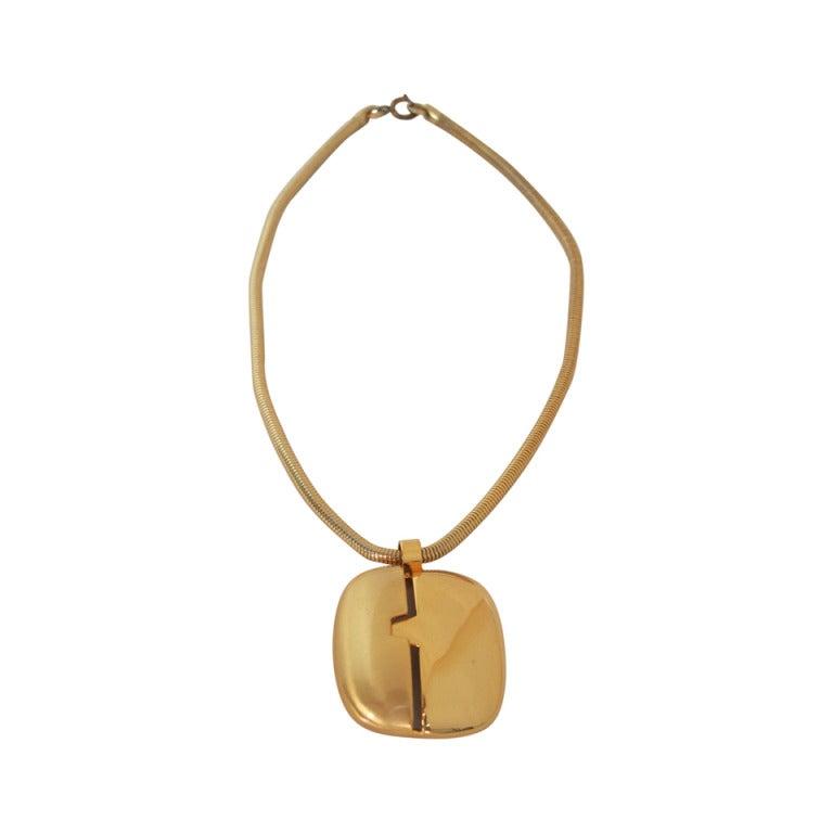 1970s Lanvin gold modernist pendant necklace For Sale