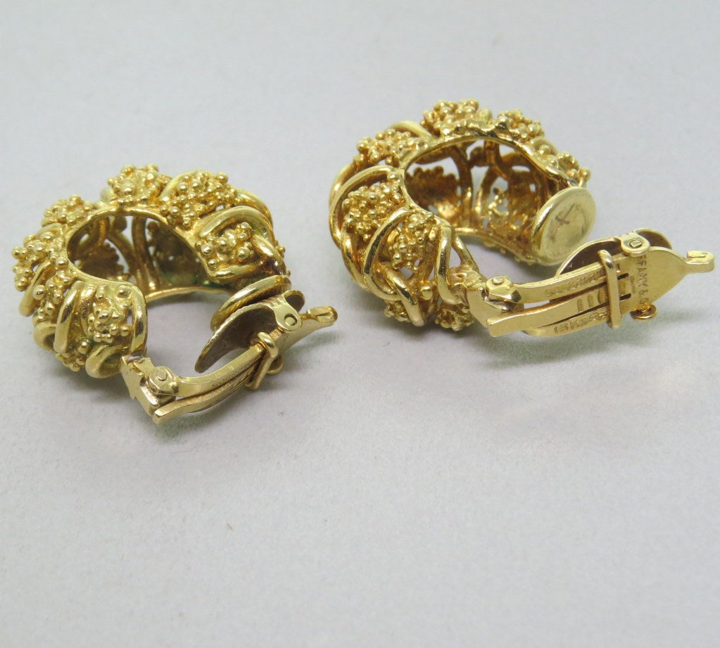 Vintage circa 1970s Tiffany & Co textured hoop earrings, measurements 23mm x 14mm. Marked - 18kt,Tiffany & Co,PT2423905. weight - 25.3g