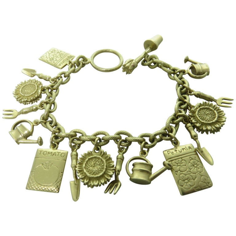 47350bfa5e7 Mish N.Y. Gold Charm Bracelet For Sale at 1stdibs