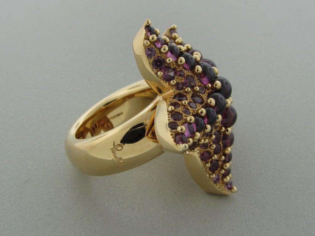 pomellato sirene rhodolite garnet gold starfish ring at