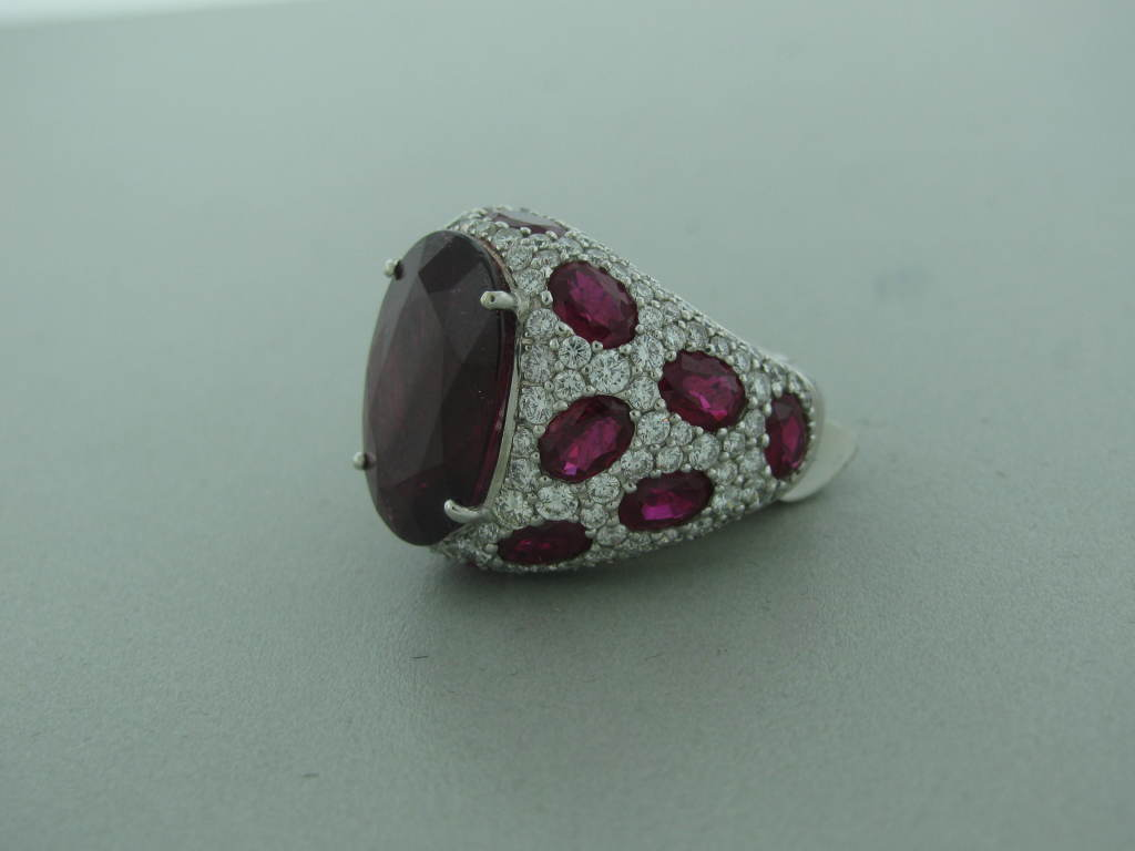 Retail: $29,000 Metal: 18K White Gold Marked / Tested: Asprey, 750 Gemstones/diamonds: Center Rubellite - 12.82Ctw Side Rubellites - 7.19Ctw Diamonds - 3.18Ctw Clarity: Vvs2 - Vs1 Color: G Measurements: Ring Size 5, Top Of Ring 20Mm X 24Mm, Sits 8Mm