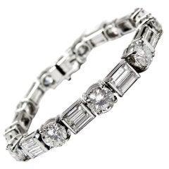 Classic Diamond Baguette and Round Diamond Line Platinum Bracelet.