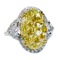 Absolutely Stunning 9.04 Carat Oval Shape Fancy Yellow Diamond