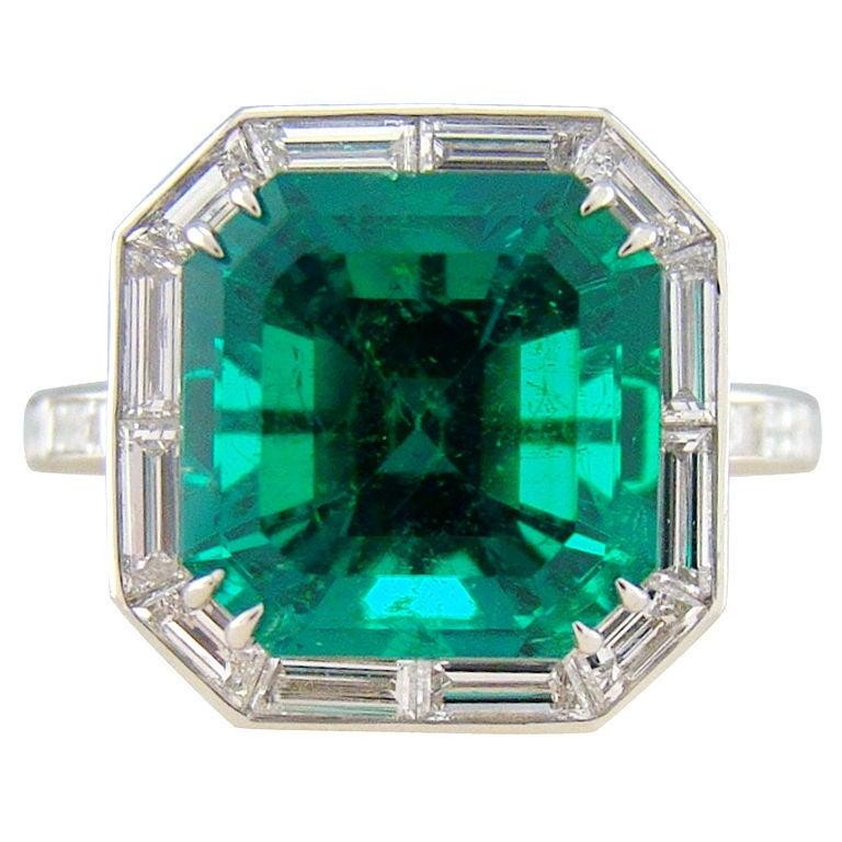 columbian emerald and baguette cut platinum ring