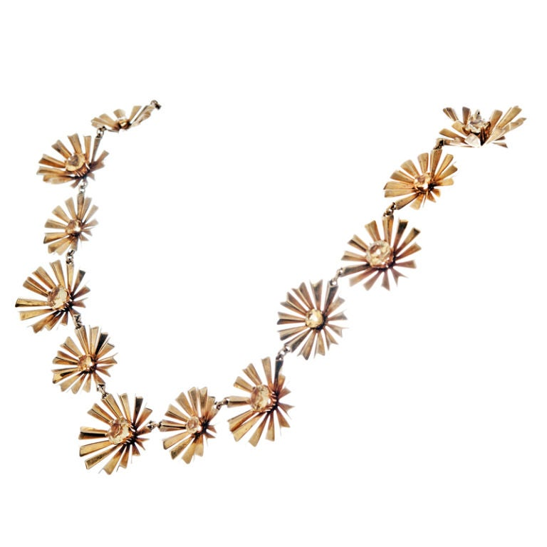 Eighteen Karat Yellow gold Starburst Necklace with Eighteen Yellow Sapphires. Designed by Ruser who was famous for being the