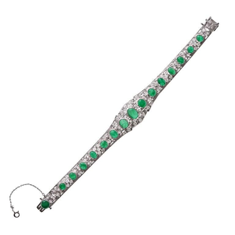 Superb example of a beautiful original handmade Art Deco period platinum bracelet measuring approximately 7 inches in length. The total diamond weight is approximately 3.5 carats and the cabochon emeralds weigh approximately 10 carats. The cabochon