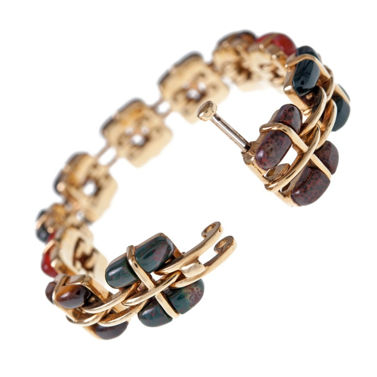 Tiffany & Co. signed bracelet handmade in 18 karat yellow gold features stones in the agate family - including tigers eye, sardonyx and bloodstone.  This bracelet measures approximately 6 - 1/2 inches in length by 1/2 inch wide.  Added all together
