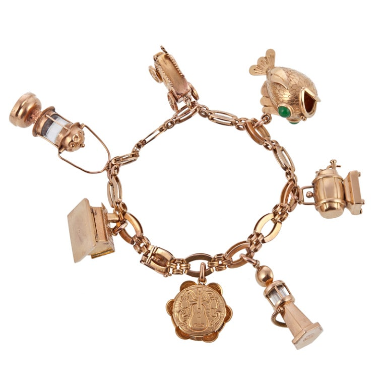 Big Charm 1940's Rose Gold Charm Bracelet at 1stdibs