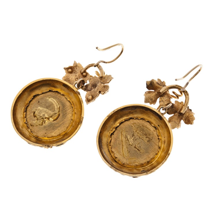 A beautiful pair of mid-1800s extra-fine pietra dura earrings. The quality of this pietra dura marbling is fantastic, particularly in conjunction with its incredible handmade settings which was fabricated in a congruent floral motif of curling