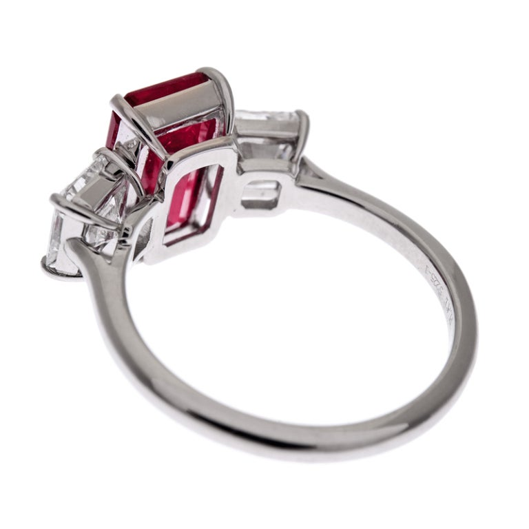 emerald cut ruby and square cut white three