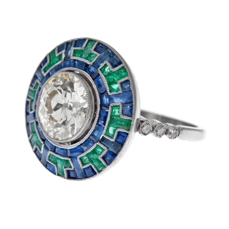sapphire emerald and platinum engagement ring at
