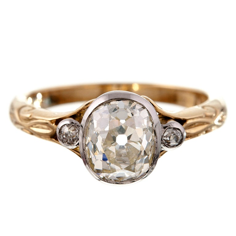 Antique Oval Cut Diamond Platinum and Yellow Gold Engagement Ring at 1stdibs