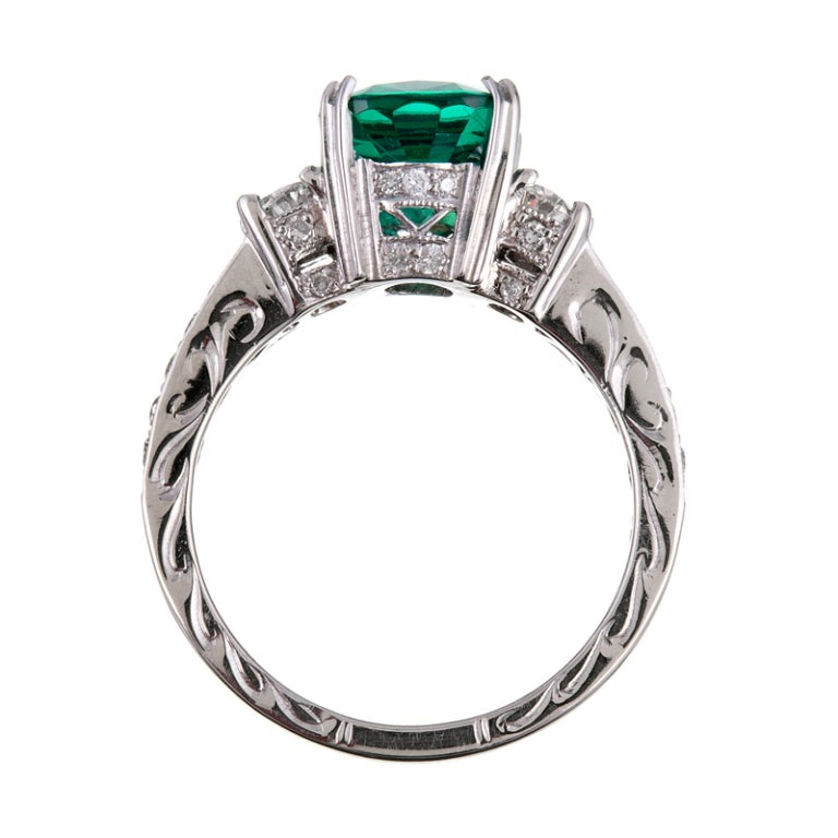 2 46ct oval emerald platinum three ring at