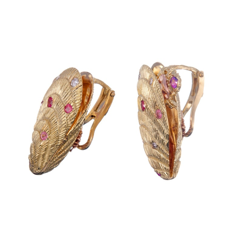 Exceptional in quality jewelry making, these shell earrings are created as a textured mussel shell with a small crab crawling out. Finished with beautiful detail front and back in 18K yellow and rose gold and speckled with pink sapphires and