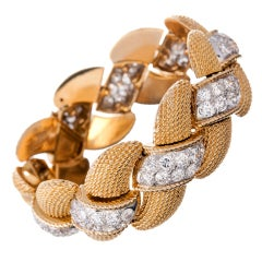 Important and Fine Braided Yellow Gold and Diamond Bracelet