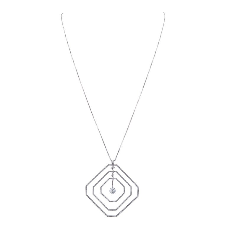 A beautiful geometrically inspired necklace, utilizing space while remaining lightweight and wearable. The overall space utilized lends this piece an impactful presence, both noticeable yet perfectly feminine. At the heart of the necklace is a