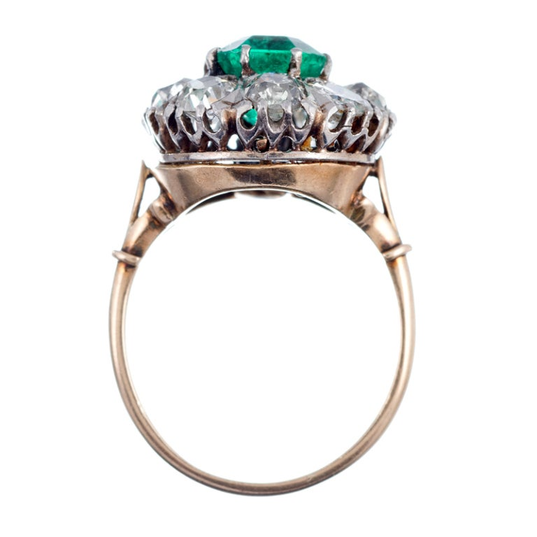 antique emerald and yellow gold cluster ring at