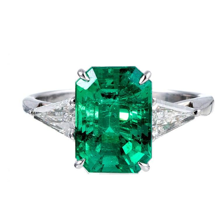 Classic 3.50 Carat Emerald and Trillion Diamond Ring 1