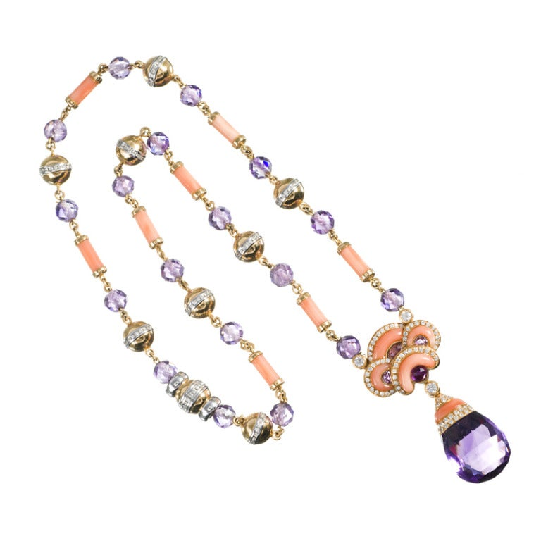 Ultra feminine and truly beautiful necklace blending soft pink carved coral, rich jewel-toned amethyst and just enough diamonds to make it even more interesting. This piece is clearly at nouveau inspired and is just assertive enough size-wise to