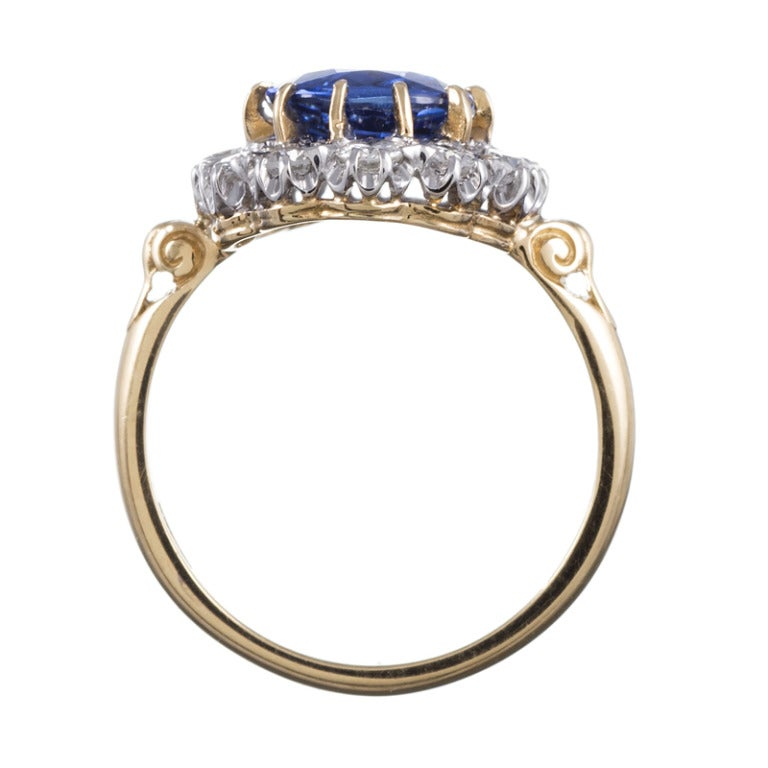 Classic Princess Diana Style  Sapphire Diamond Cluster Ring In As New Condition For Sale In Carmel-by-the-Sea, CA