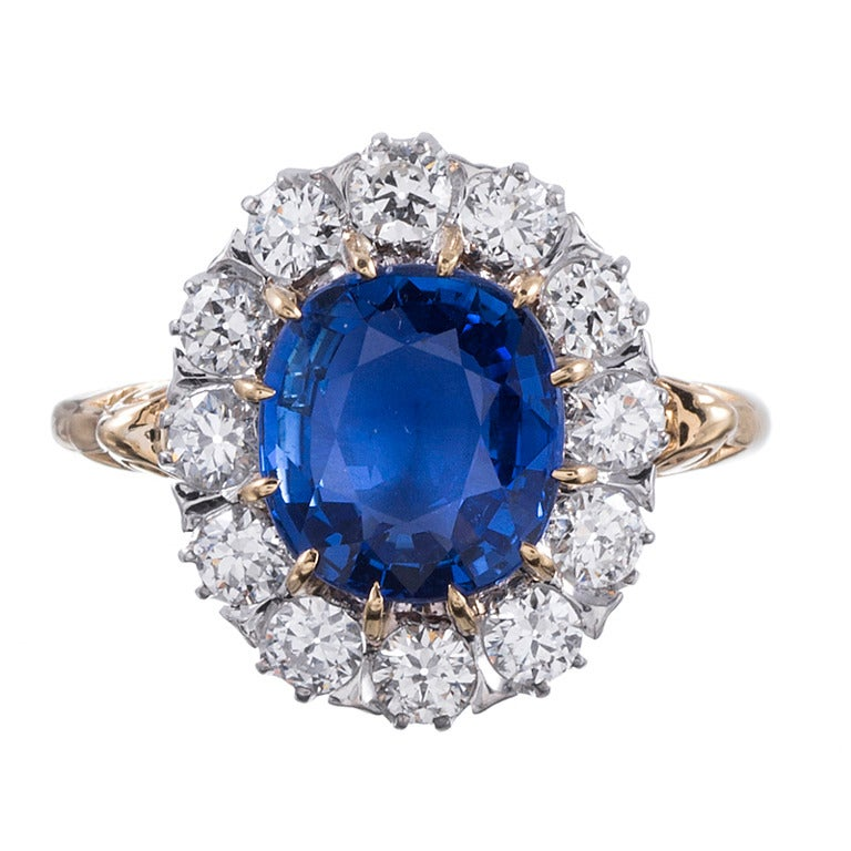 Classic Princess Diana Style  Sapphire Diamond Cluster Ring For Sale