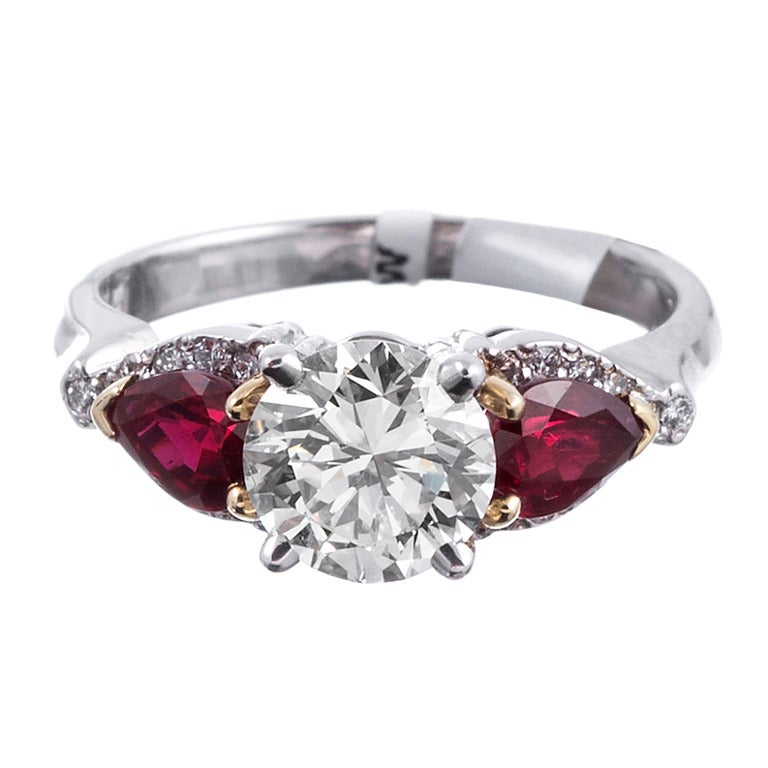 138 carat round diamond ring with intense red pear shaped for Wedding rings with rubies and diamonds