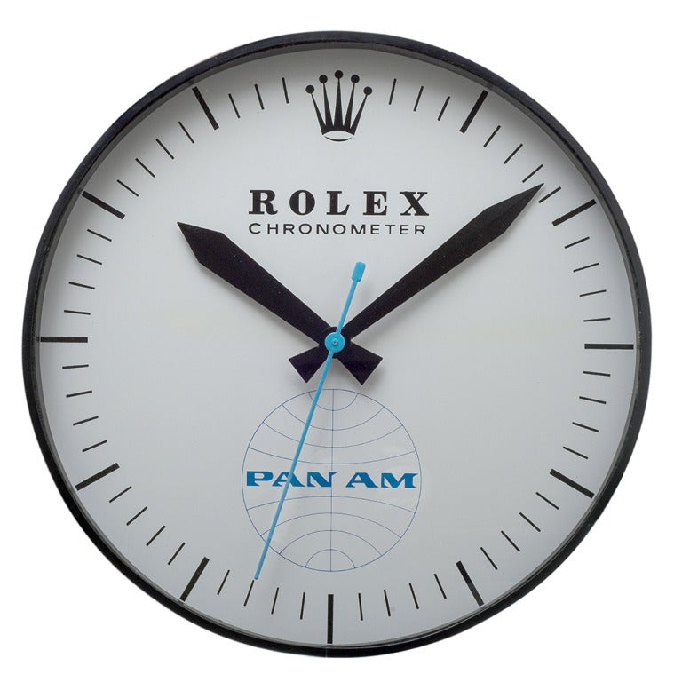 Rolex Pan Am plug–in wall clock from circa 1960 which previously hung in Pan Am's headquarters in NYC. Rolex and Pan Am had a special relationship, as Rolex developed the GMT for Pan Am pilots to be able to tell time simultaneously in two time zones