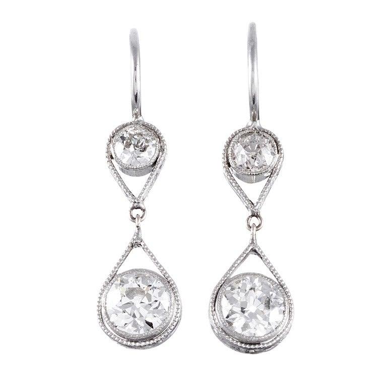 Antique American Double Diamond Drop Earrings, circa 1920 For Sale