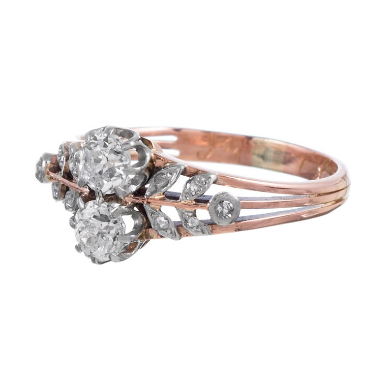 14k rose gold ring with a platinum top and a charming floral motif, decorated with diamonds. For the antique jewelry enthusiast who would like a non-traditional wedding ring or for the lover of all things one-of-a-kind, this is the ideal piece.