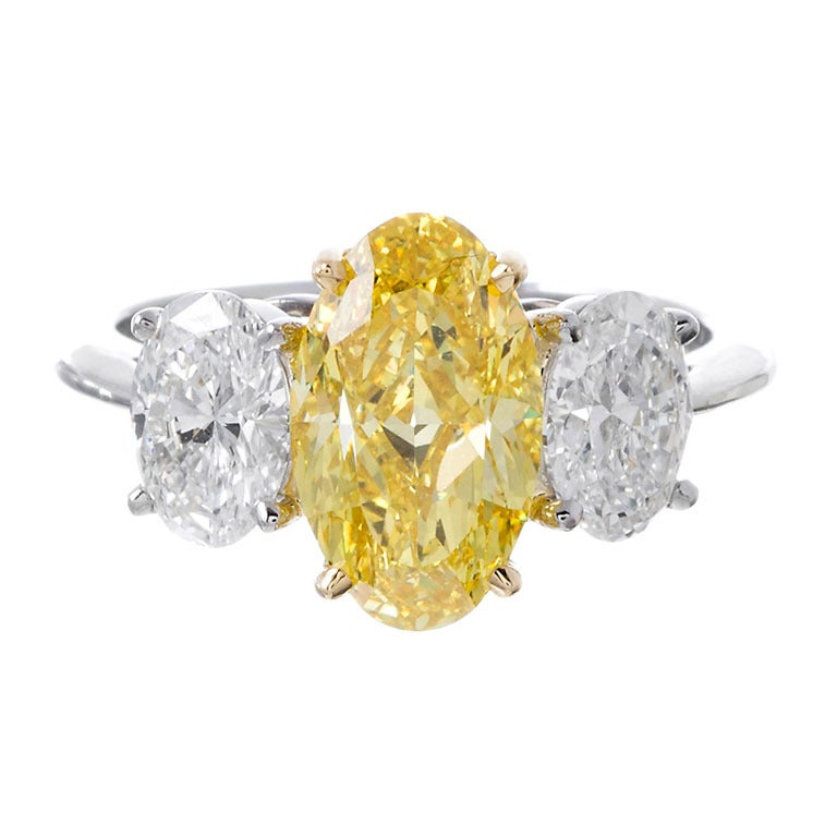 2 42 Carat Fancy Yellow Three Stone Oval Diamond Ring For