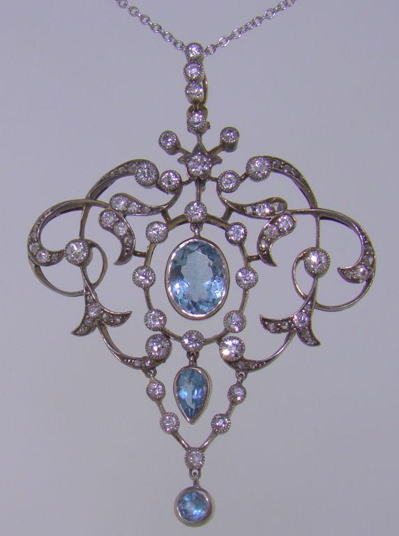 A Platinum, 18K Yellow Gold, Aquamarine & Diamond Pendant - Handmade, Thirty-nine Old-European-Cut Diamonds, Twenty-five Rose-Cut Diamonds, Three Fine Aquamarine Gemstones, circa 1900<br /> Measures 1.50