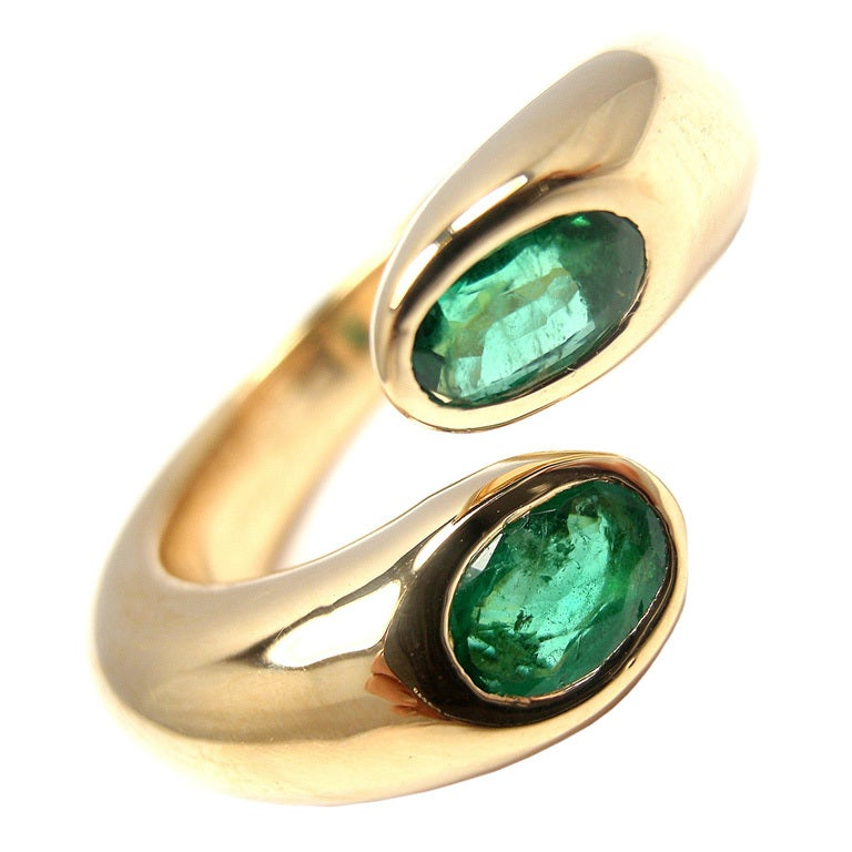 cartier ellipse deux tetes croisees 18k emerald ring at