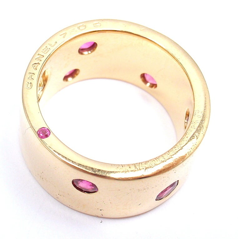 18k Yellow Gold Ruby & Yellow Sapphire Band Ring by Chanel. With 1 x Yellow Sapphire, Totaling Approx .10ctw 6 rubies, 3mm each  Details:  Ring Size: 6 Width: 10mm Weight: 17.3 grams Stamped Hallmarks: Chanel 750 (serial number has rubbed