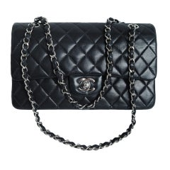 CHANEL PARIS Classic 2.55 Black quilted leather purse