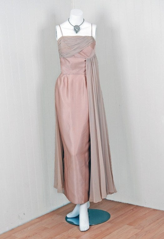 """In this gorgeous 1950's """"Edward Abbott"""" designer champagne gown, the detailed construction and meticulous attention to detail are comparable to what you will find in modern haute-couture. This enchanting garment is fashioned from shimmering satin"""