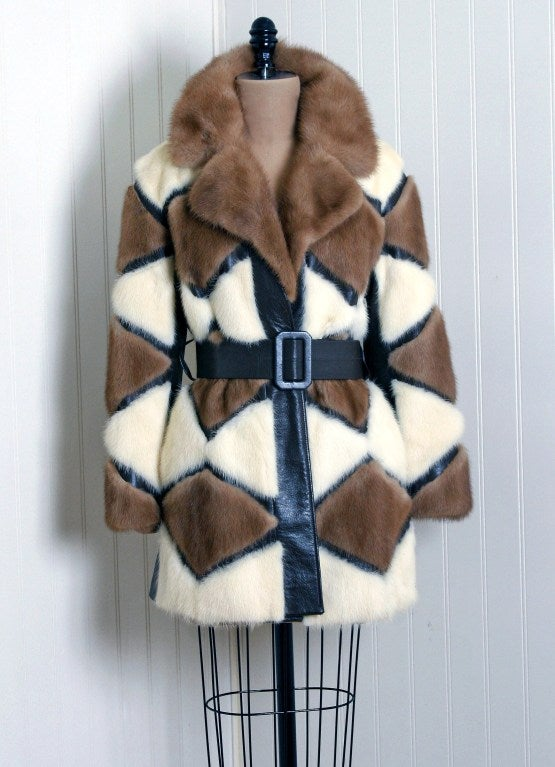 This exquisite 1960's genuine mink-fur and leather coat will make any woman shine during the upcoming cold winter months. The soft mink has been worked into an almost diamond chevron pattern and the effect is really breathtaking. The care to piece