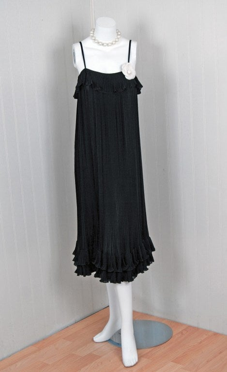 Chanel is known to be one of the most luxurious and decadent fashion houses in the world. This breathtaking black silk-chiffon cocktail dress is a perfect example of why this couture brand has stood the test of time. Not only is this little number