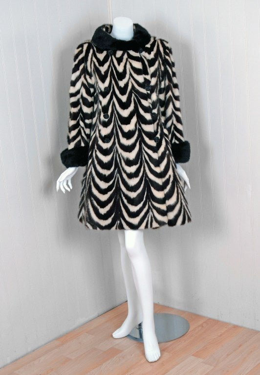 This exquisite 1960's ivory-white and dark-chocolate brown genuine mink-fur coat will make any woman shine during the upcoming cold winter months. The soft mink has been worked into an almost op-art zebra striped pattern and the effect is really